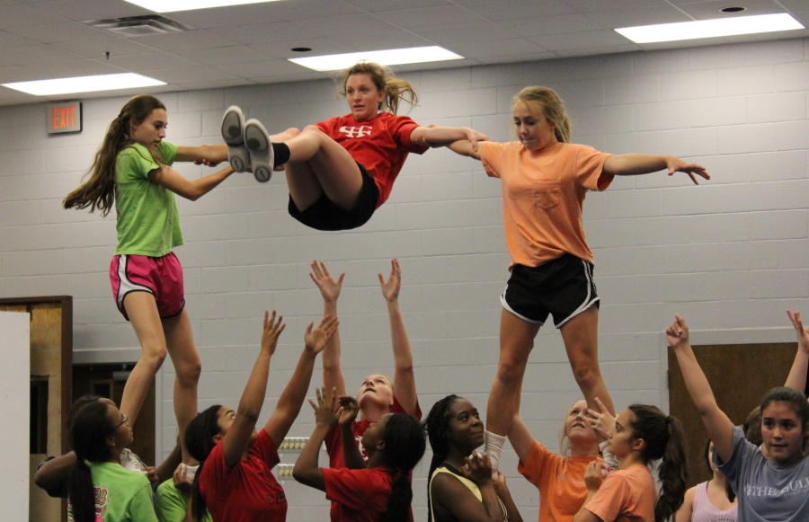 The CHHS Cheer Team, shown practicing in October, earned the title of Regional Champions at the Mid-South Regional cheer competition. The team also earned a bid to the National High School Cheerleading Championship in February.