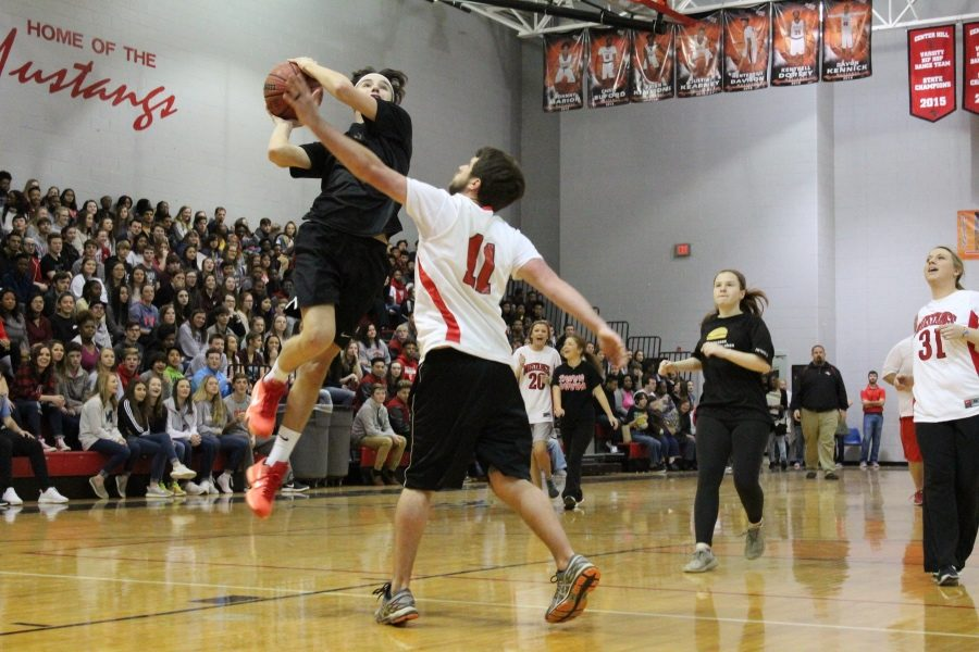Teachers dominated students 45-28 in the Faculty vs. Students basketball game on Jan. 26. The fundraiser netted $3,600 for the Student Council.