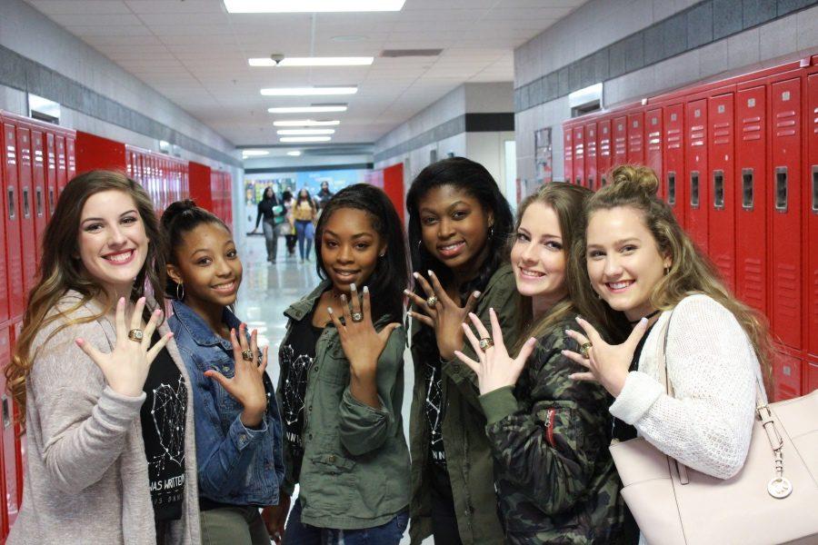 Brittnie Sandridge, from left, Devyn Baker, Kennedi Evans, Tiana Baldwin, Lydia Walker and Emma Freeze show off their state championship rings.