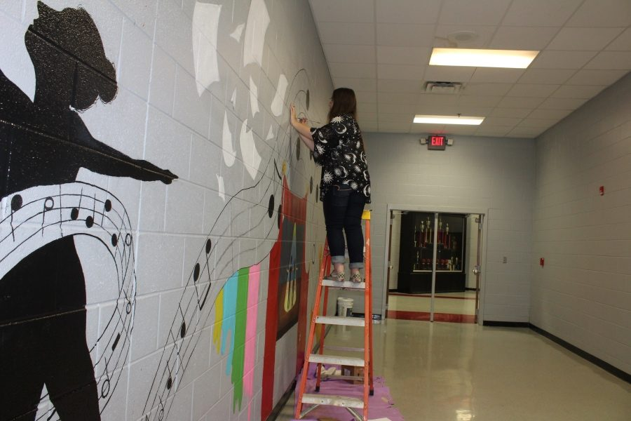 Savannah Downing's inspiration for the mural she designed and painted came from her friends who are involved in the performing arts.