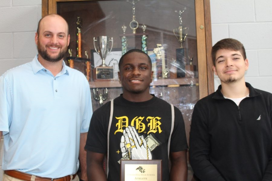 Allen Palmer of Farm Bureau Insurance, left, stands with Matt Burrow, Farm Bureau's Athlete of the Month for August, and Jovani Jiminez, Farm Bureau's Student of the Month for August.