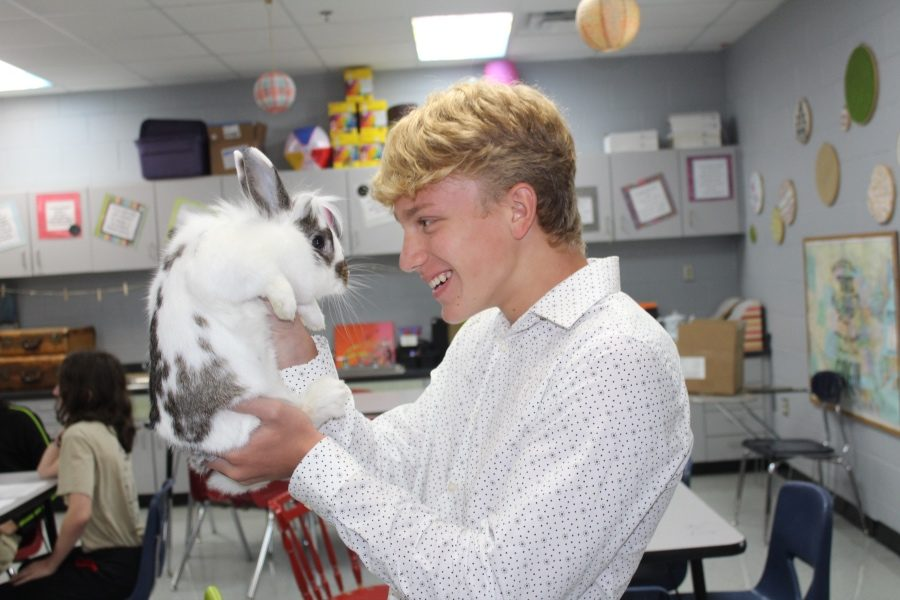 Freshman Caden Tackett holds Oreo, one of the pets in Kerry Matthews' biology classroom.