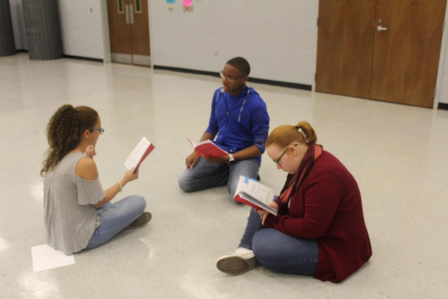 """CHHS drama students McKayla Beckmann, from left, Joseph Griffin and Christina White rehearse lines from the play """"Suite Surrender."""" The play, a farce set in the 1940s, will be performed Dec. 7-9."""