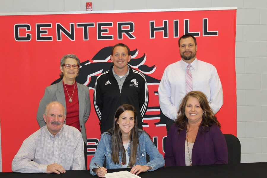 Logan Tomlinson, a midfielder for the Lady Mustangs, signed Nov. 13 to play soccer at Northwest Mississippi Community College.