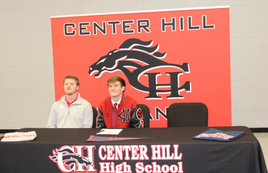 Dylan Riley, a center back for the Mustangs, signed Feb. 22 to play soccer with Northwest Mississippi Community College. He is pictured with boys soccer coach Andrew Yeoman.
