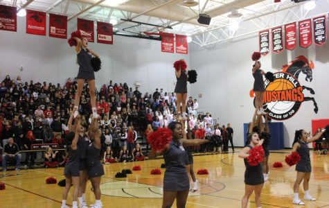 CHHS Cheer, shown performing at a pep rally, placed 17th in the nation in a UCA competition in February.