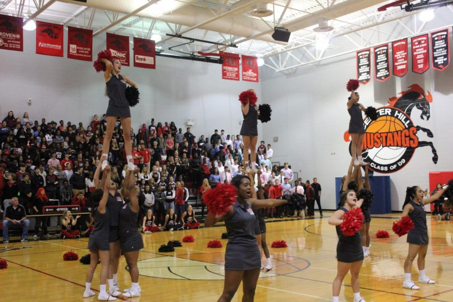 CHHS+Cheer%2C+shown+performing+at+a+pep+rally%2C+placed+17th+in+the+nation+in+a+UCA+competition+in+February.