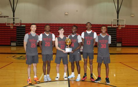 Wearing their practice jerseys, seniors Calvin Temple, Kevin Henry, Cameron Goodwin, Marquez Berry, Antwan Honer and Kenneth Lewis pose with the Gold Ball trophy they brought home March 8 after defeating district rivals Olive Branch 75-73 in the Class 5A State Championship. The win at the Big House in Jackson marks the first state basketball title in school history.