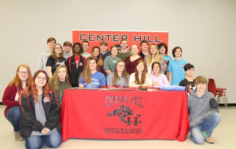 Surrounded by her teammates, Hannah Willard signed April 23 to join the archery team at Blue Mountain College.