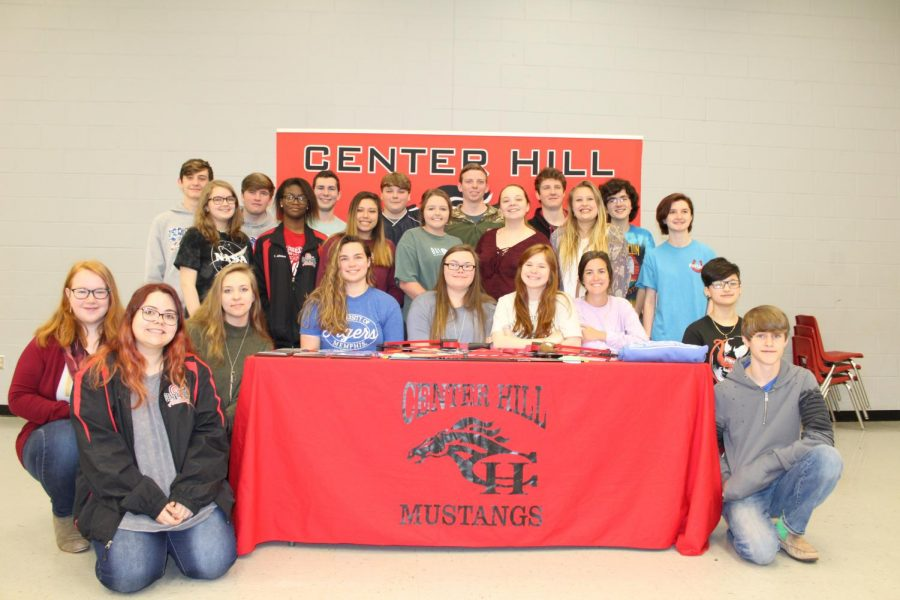 Surrounded+by+her+teammates%2C+Hannah+Willard+signed+April+23+to+join+the+archery+team+at+Blue+Mountain+College.