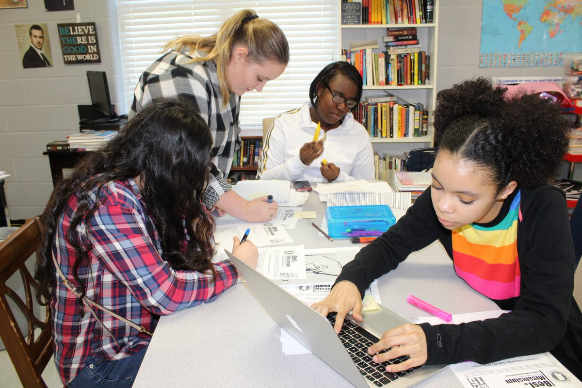 Using guidelines from the Mississippi Scholastic Press Association, Nada Herzallah, from left, Paige Brick, Nadia Sumlar and Kris Randle select entries for inkstained, CHHS's literary magazine. The theme of this year's issue is Inside My Head.