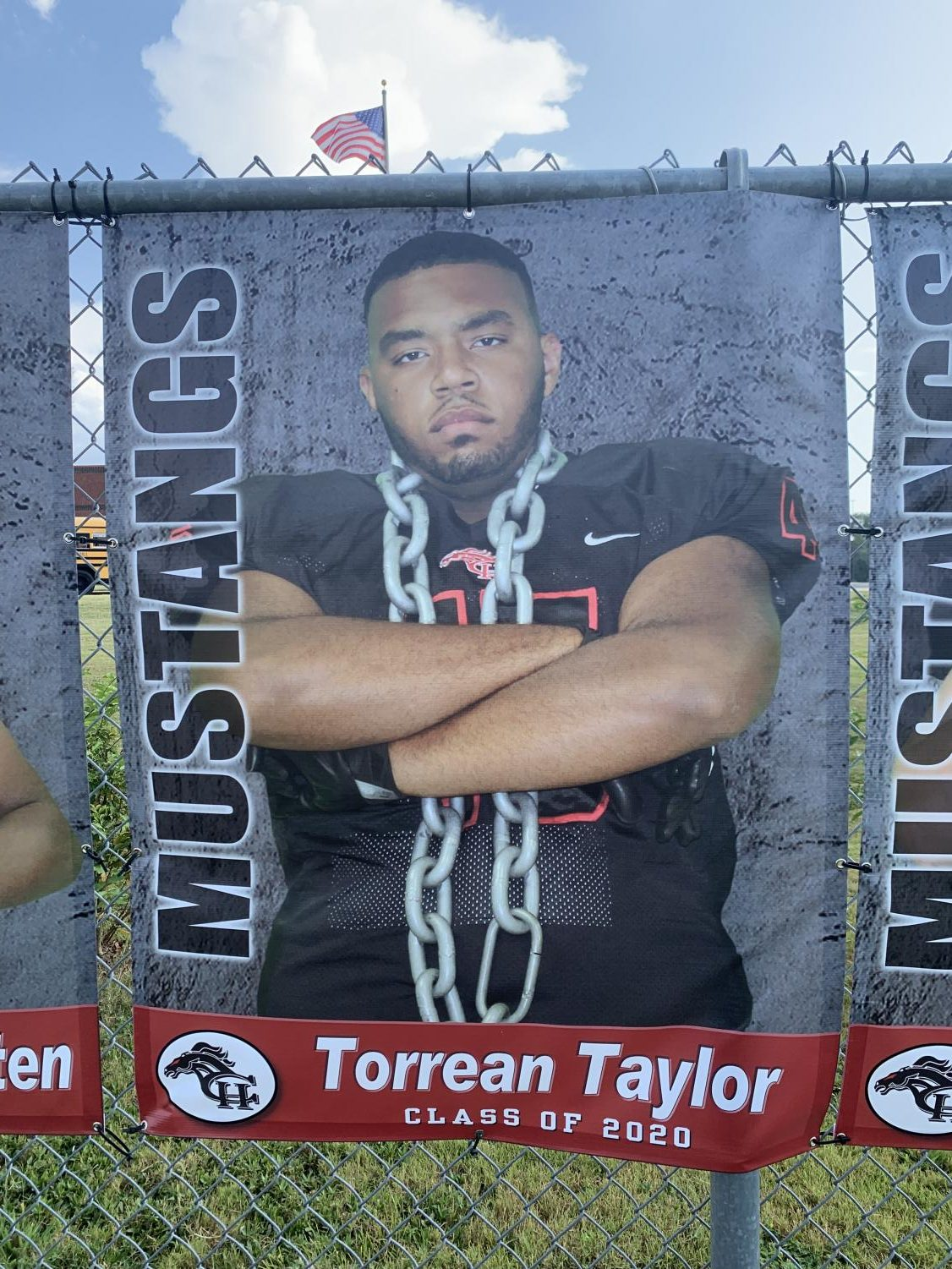 """Torrean Taylor's senior banner hangs at Mustang Stadium. Taylor, also known as """"Big T,"""" suffered a broken leg in the Sept. 6 game against Southwind. Following surgery, Taylor is at home recovering and will return to school soon."""