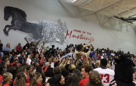 Senior Mario Franklin crowd surfs at the first pep rally of the year Aug. 23.