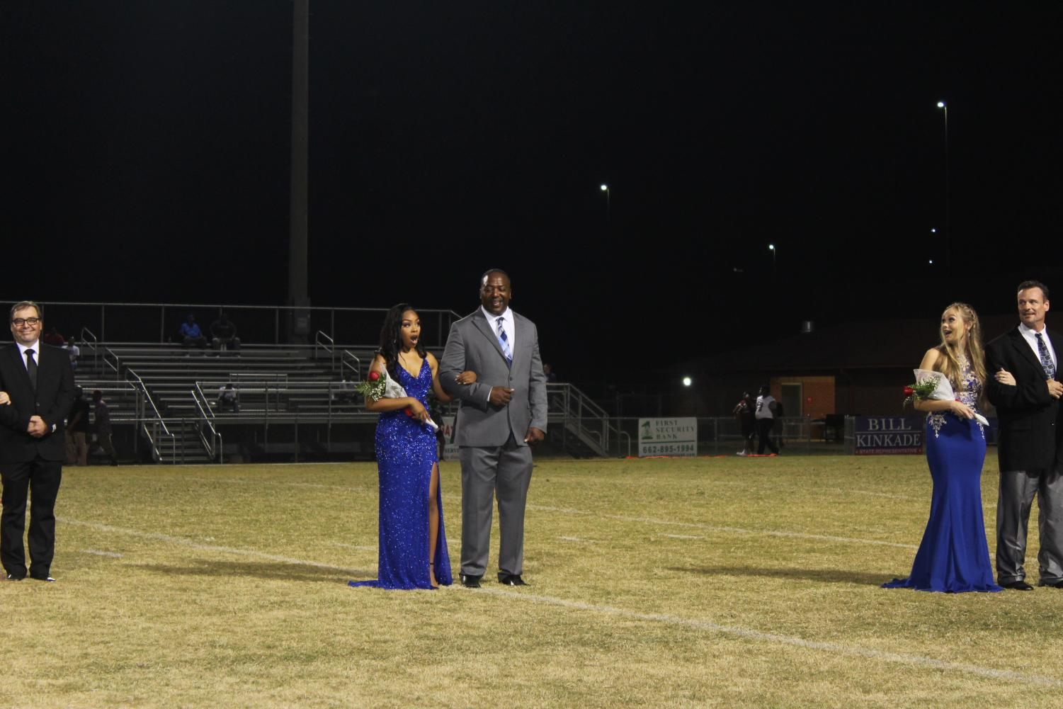 Kennedi Evans reacts to being named Homecoming Queen during halftime of the Sept. 13 game against Douglass High School.