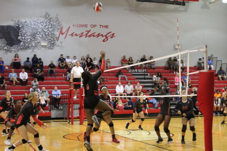 Senior Lauryn Bulloch pushes the ball while her teammates cover during an Aug. 20 match against Southaven. The Mustangs won the home non-conference match 3-0.