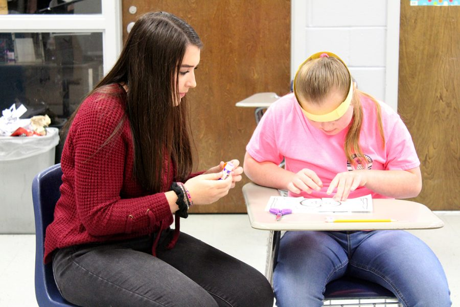 """Students with Down syndrome should not be treated differently, said Ashley Halford, left, a Best Buddy to Jayme' Guyer. """"Their disability is what makes them, them,"""" Halford said. """"They are just like the rest of us."""""""