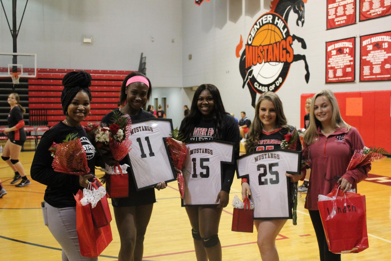 Volleyball players and managers were recognized at Senior Night Oct. 8. From left are Jada Totten, manager; Zakhia Taylor, middle hitter; Lauryn Bulloch, right side hitter; Lydia Walker, outside/right side hitter; and Lunden Crews, manager. Anna Jernigan, libero, had the flu and missed the event.