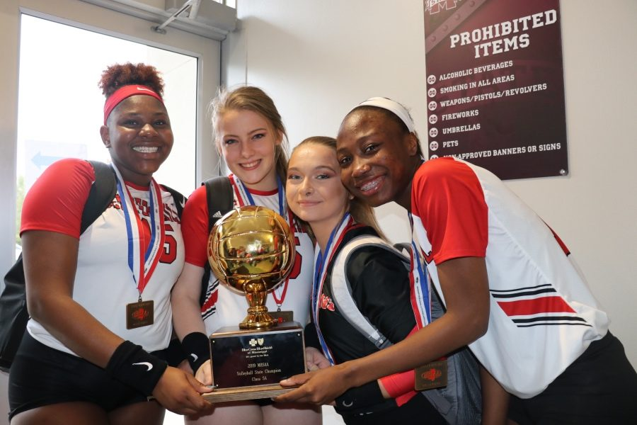From left, seniors Lauryn Bulloch, Lydia Walker, Anna Jernigan and Zakhia Taylor pose Oct. 26 with the gold ball trophy. The Mustangs defeated Long Beach 3-1 to win the MHSAA Class 5A volleyball state championship in Starkville.