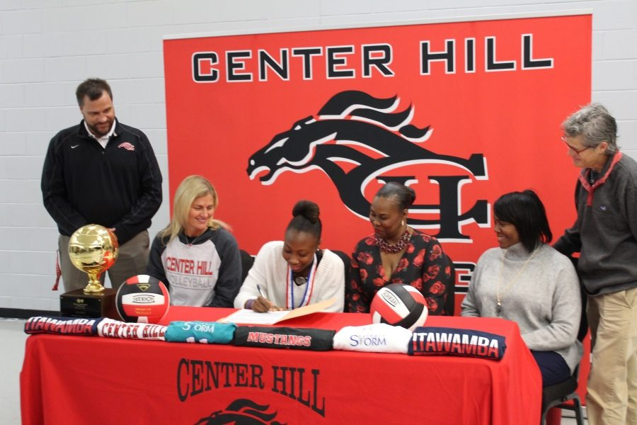 With her family, coach and administrators looking on, Zakhia Taylor, center, officially signed Nov. 8 to play volleyball with Itawamba Community College.