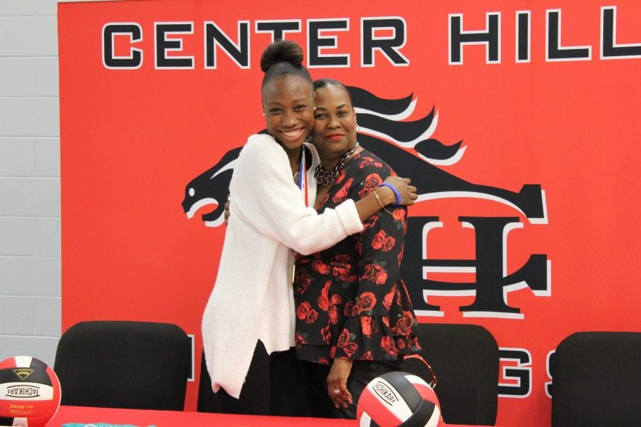 Zakhia Taylor hugs her mother, June, after signing Nov. 8 to play volleyball with Itawamba Community College.