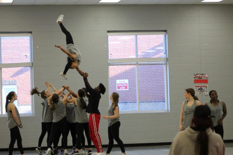 Dance sponsor Kerry Matthews said having strength and height is an advantage in hip hop. At 6 feet 2 inches tall, Mark Holmes can easily lift his teammates, like Kennedi Evans as pictured here.