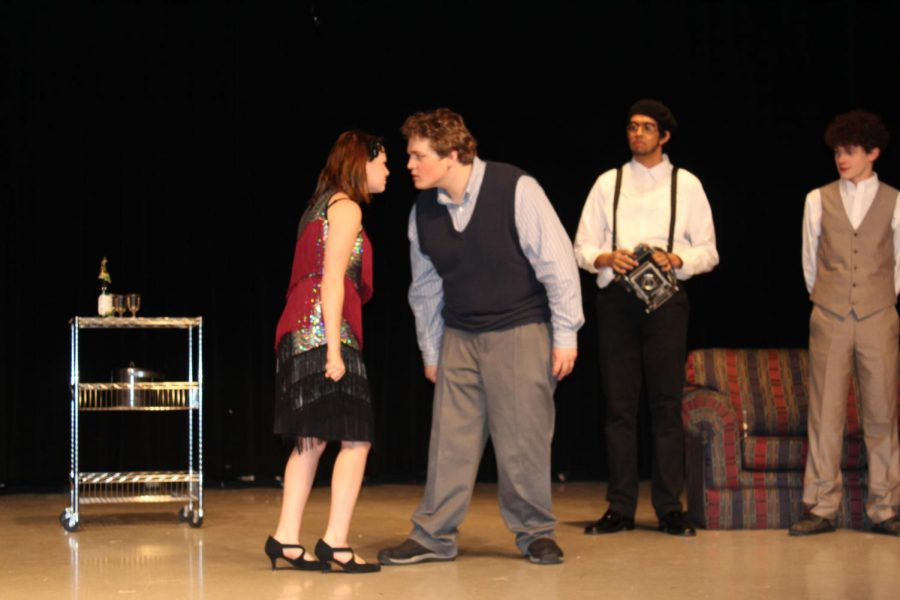 Myrtle Wilson, portrayed by Madison Spivey, and Tom Buchanan, played by Jacob Money, argue in a scene during a dress rehearsal of