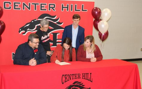 Maggie Gaines signed today to play soccer at Hinds Community College. She is seated with her father, Tim Gaines, and her mother, Rachel Robertson. Standing from left are Assistant Principal Brenda Case and head girls soccer coach Ryan Worsham.