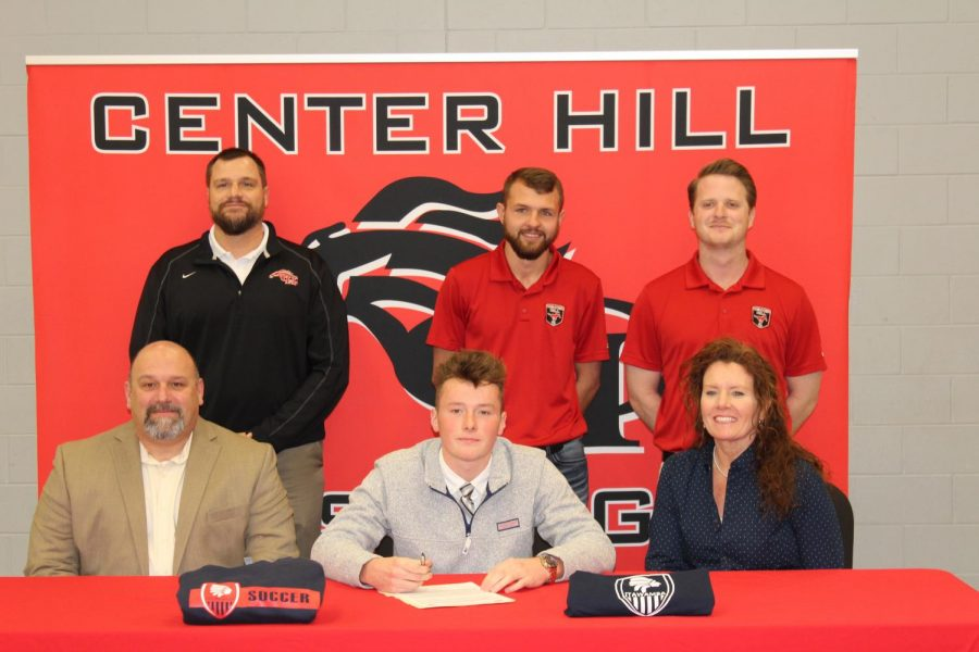 Hart Smith, a right winger for the Mustangs, signed Jan. 10 to play soccer for Itawamba Community College. He is pictured with his parents, Greg Smith and Julie Smith and, back row from left, Principal Doug Payne, coach Blake Lashlee and head coach Andrew Yeoman.