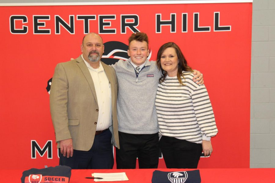Hart Smith is pictured with his dad and stepmom, Greg and Melissa Smith, after signing Jan. 10 to play soccer at Itawamba Community College.