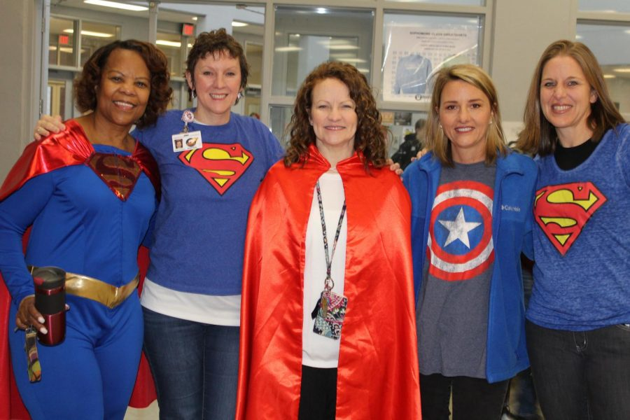 For Super Hero vs. Super Sleepy Day, these teachers dressed as super heroes. From left are math teacher Jackie Wooten, English teacher Ginny Shikle, math teacher Sara Flowers, science teacher Kerry Matthews and girls basketball coach Emily Owens.