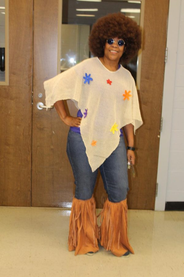 Math teacher Jackie Wooten wore her 70s best for History vs. Future dress-up day.