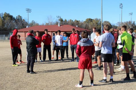 Head boys soccer coach Andrew Yeoman speaks to the team before a practice in November. The Mustangs, with a 16-1 record, won their first ever state championship Feb. 8 against Long Beach.