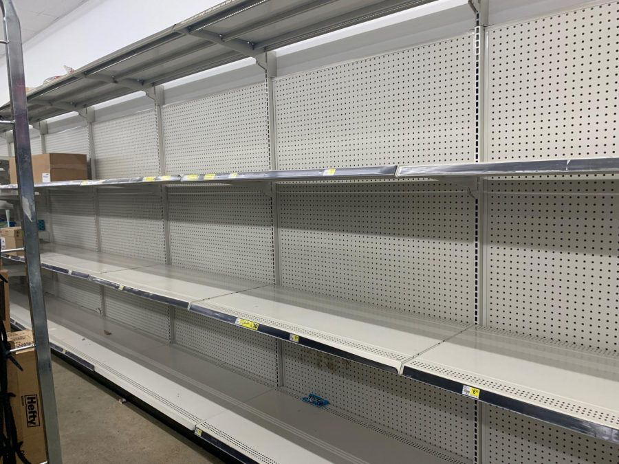 "As people self-isolate to stop the spread of the coronavirus, shoppers have hoarded toilet paper and cleaning supplies. Jacob Black, a junior, said the pandemic has created an inconvenience. ""People bought all the toilet paper at Kroger,"" he said. Empty shelves from Dollar General on 178 in Olive Branch are pictured here."