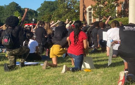 At a peaceful Black Lives Matter protest June 6 in front of the Olive Branch City Hall, protesters kneeled on the ground for 8 minutes and 46 seconds, the amount of time Derek Chauvin pinned George Floyd to the ground. The group prayed and raised their fists against systemic racism in this country.