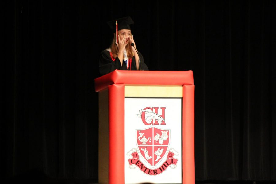 Salutatorian Destiny Pettis wipes away tears during her graduation speech. Pettis's overall average was 100.6.