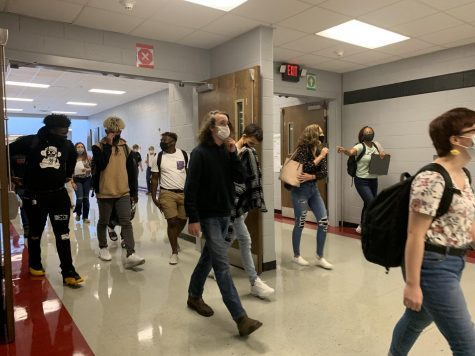 "Students returned to school wearing masks and practicing social distancing. ""We want to make this the best learning experience we can have but we do have to follow a lot of safety guidelines,"" Principal Doug Payne said."