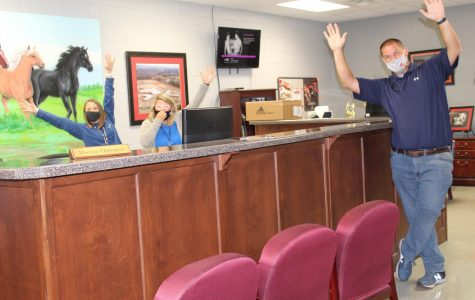 From left, receptionist Mandi Osborne, school nurse Brittany Crum, and Assistant Principal Zack Sims react to the announcement that CHHS is a National Blue Ribbon School. Principal Doug Payne said plans for a celebration are in the works.