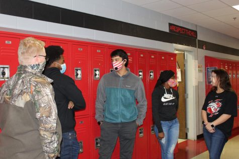 Students have many options for face coverings to protect themselves and others during the pandemic. From left, junior Nicholas Minott wears a neck gaiter, junior Lawrence Jones wears a surgical mask, junior Omar Almuntaser wears an N95 mask, sophomore Jamya Hassell wears a cloth mask, and sophomore Lorie Buckley wears a clear face shield.