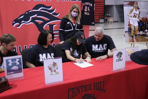 Hope Mealer, pictured with her family and Mineral Area College women