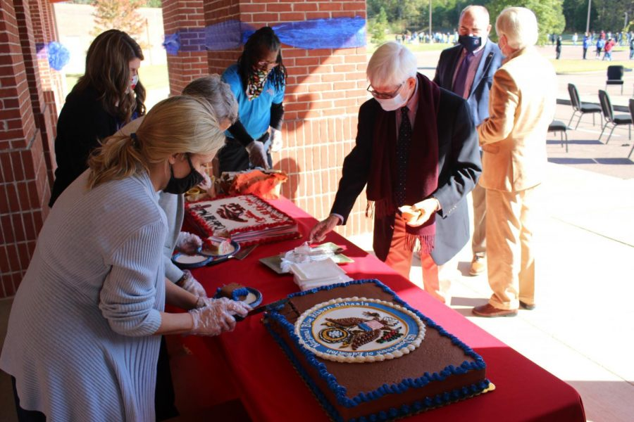 District 1 school board member Milton Nichols gets ice cream and cake served by counselor Meredith Smith, Assistant Principal Brenda Case, counselor Danielle Brown, and Ron Thompson from the maintenance department.