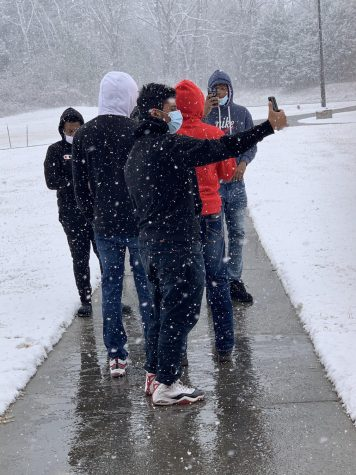 Sophomore Omar Alomri and his classmates take pictures of the snowfall at school during 2nd block today. According to the National Weather Service, DeSoto County had a 20 percent chance of snow showers this morning.
