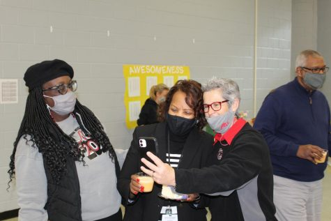 Cynthia Bobo, left, looks on as Jacqueline Wooten takes a selfie with Assistant Principal Brenda Case. Wooten was recognized as the CHHS Teacher of the Year today.