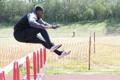 Laynce Henderson jumps a hurdle during the CH Track Mustang Relays April 1.