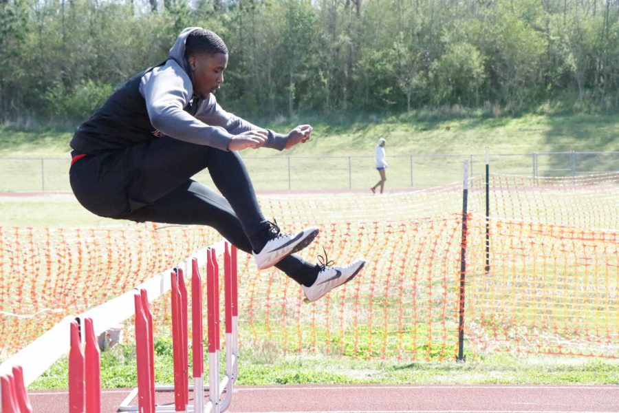 Laynce+Henderson+jumps+a+hurdle+during+the+CH+Track+Mustang+Relays+April+1.