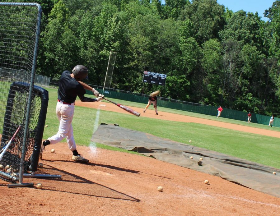"""Braxton Miller takes batting practice with the Mustangs May 12. The senior, who plays shortstop, said his team has rallied this year despite difficult circumstances. """"I think we all had that mindset that, you know, no one really believes in us besides us, and no one expects us to do much this year,"""" he said. """"With that, we just wanted to go out there and prove some people wrong."""""""