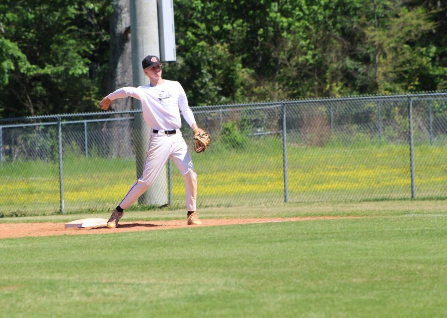 Joey Dunning, first baseman, throws the ball in to the catcher during baseball practice May 12.