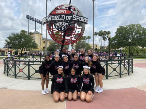 The cheer team poses in front of Disney Worlds ESPN Wide World of Sports Complex. The team made school history with their first ever top 10 finish in the National Cheerleading Championships.