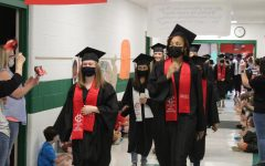 After a Senior Breakfast Social in the cafeteria and a graduation practice in the gym, on May 19 the Class of 2021 participated in the annual Grad Walk at Overpark and Center Hill elementary schools. Shown from left to right are Rebekah Wright, Leslie Alvarado, Brinley Steed and Kassidy Burrage.