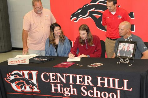 With his family and coach David Burgess looking on, former CHHS golfer Cooper Haney officially signs with Dallas Christian College.